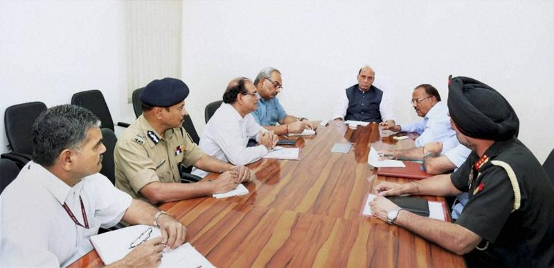 Home minister Rajnath Singh holding a high-level security meeting at his residence in New Delhi on Sunday. (PTI Photo)