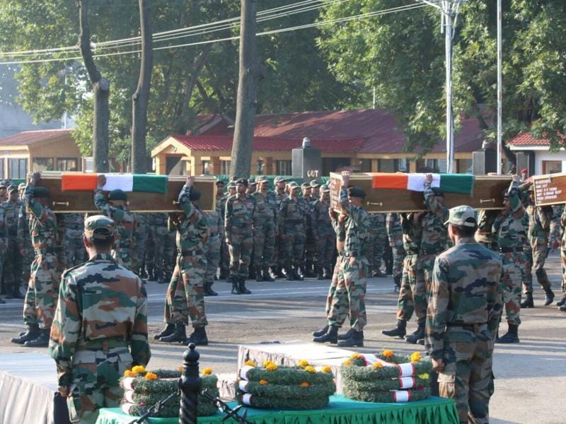 Indian Army soldiers pay last respects to soldiers killed in the Uri attack, in Srinagar. (Picture Courtesy: Indian Army)
