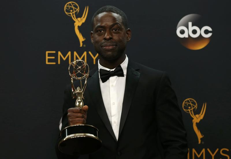 Actor Sterling K. Brown poses backstage with his award for Outstanding Supporting Actor In A Limited Series Or Movie for FX Network's