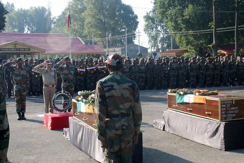 A senior Police officer paying tribute to the soldiers killed in Uri attack in Srinagar on Monday.  (PTI)