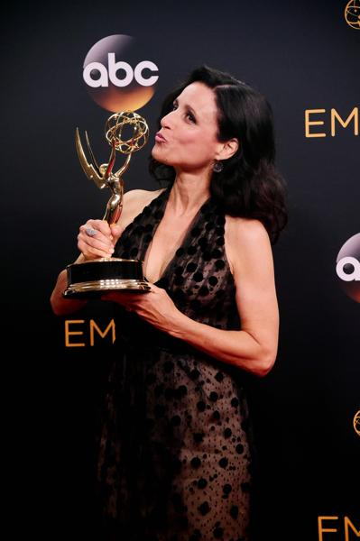 Julia Louis-Dreyfus poses in the press room with the Emmy for Outstanding Lead Actress in a Comedy Series for