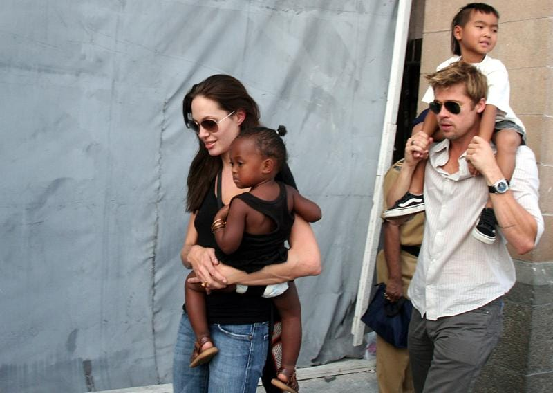 Angelina adopted another child, this time a girl from Ethiopia, Zahara in 2005. Jolie, left, with her daughter Zahara, and Brad Pitt, right, with Jolie's son Maddox, walk near the Gateway of India in Mumbai, India in 2006.  (AP)