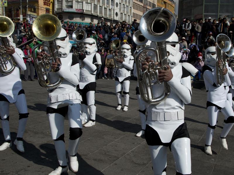 A student band dressed as storm troopers play the Star Wars song Imperial March through downtown La Paz, Bolivia. The band was led by their band director who was dressed as Darth Vader. The band, from the indigenous Aymara town of Caracollo, Oruro, was noticed at a local school band competition in Cochabamba and invited by television stations in the capital. (AP)