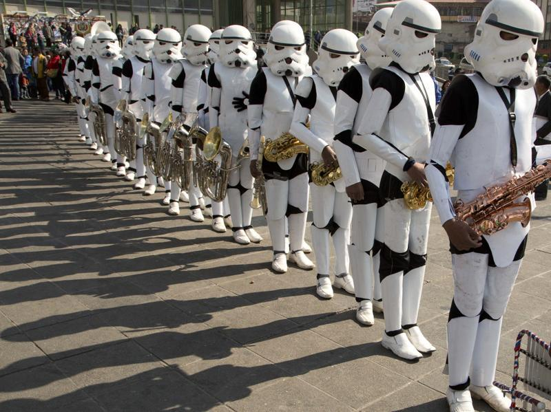 A student band dressed as storm troopers hold their instruments after playing the Star Wars song The Imperial March. (AP)