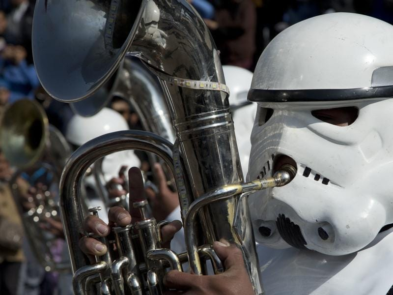 A student band member dressed as a storm trooper plays the Star Wars song Imperial March through downtown La Paz, Bolivia. (AP)