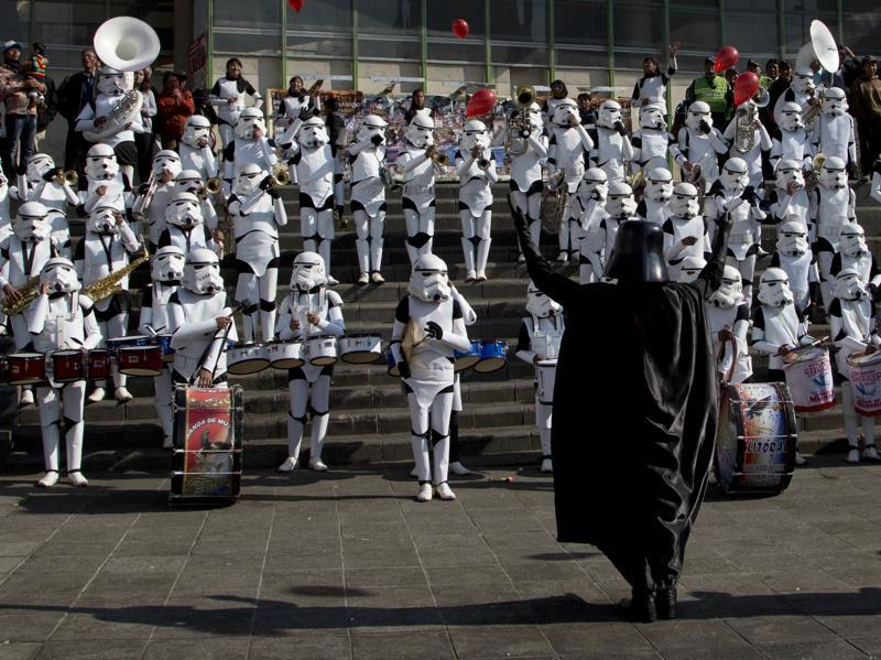Band director Jaime Flores, dressed Darth Vader, leads his students dressed as storm troopers in the Star Wars song The Imperial March in La Paz, Bolivia. (AP)