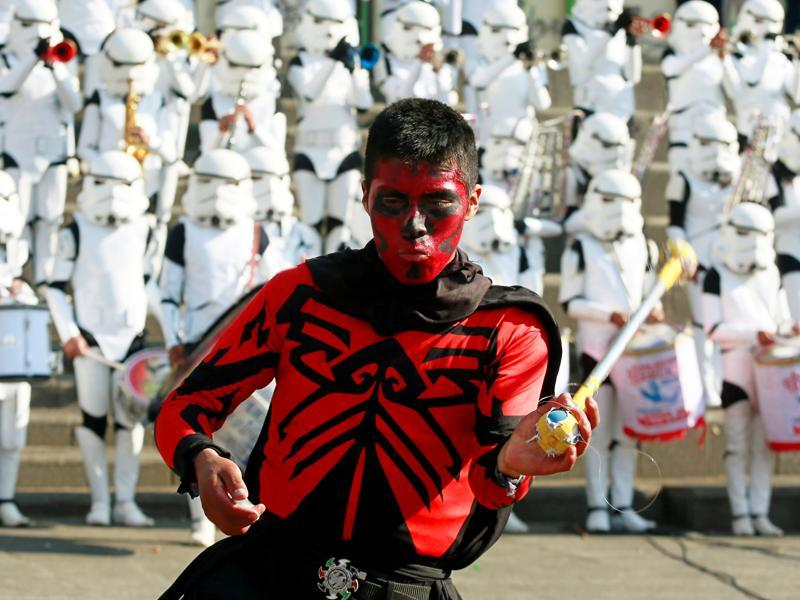 A member of Litoral school band from Caracollo wearing a Darth Maul costume from Star Wars performs at San Francisco square in the centre of La Paz, Bolivia. (REUTERS)