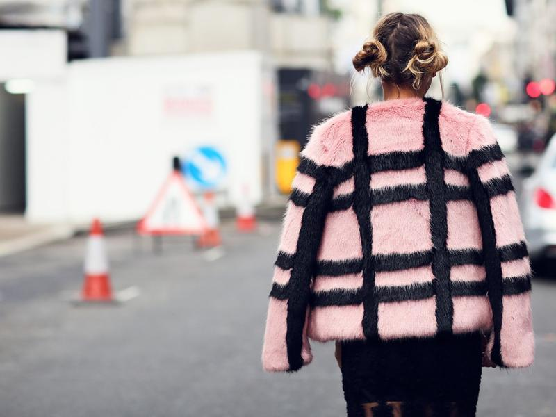 Not sure what we're into more, the grid-patterned coat, or the Baby Spice-style buns. (Instagram)