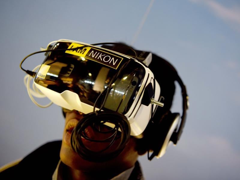 Visitors test Virtual Reality glasses at the Nikon stand.  The fair caters to the photographic and imaging sector, and presents products from image capture, image processing and storage to image output.  (Patrik stollarz / AFP)