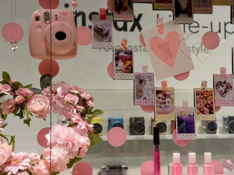The Fuji stand is a vision in pink and polaroid, with an array of brightly coloured cameras on offer for the stylish customer.  (Patrik stollarz / AFP)