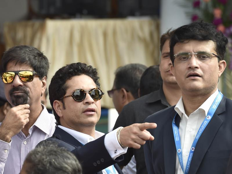 Former cricket team captains Sachin Tendulkar and Saurav Ganguly before being felicitated by Uttar Pradesh governor Ram Naik and BCCI president Anurag Thakur on the occasion of India's landmark 500th Test match between India and New Zealand at Green Park Stadium in Kanpur, Uttar Pradesh, on September 22, 2016. (Ajay Aggarwal/HT PHOTO)