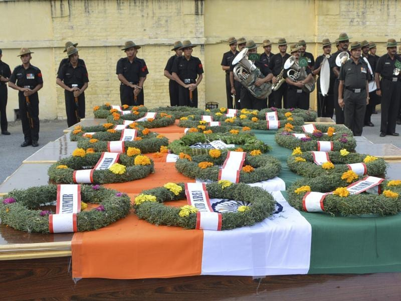 The bodies of six army jawans from eastern UP and Bihar reached the Lal Bahadur Shashtri international airport in Varanasi on September 19, 2016.These soldiers are among the 18 killed in a terror attack on an army base at Uri in Jammu and Kashmir on September 18, 2016.  (Rajesh Kumar/HT Photo)