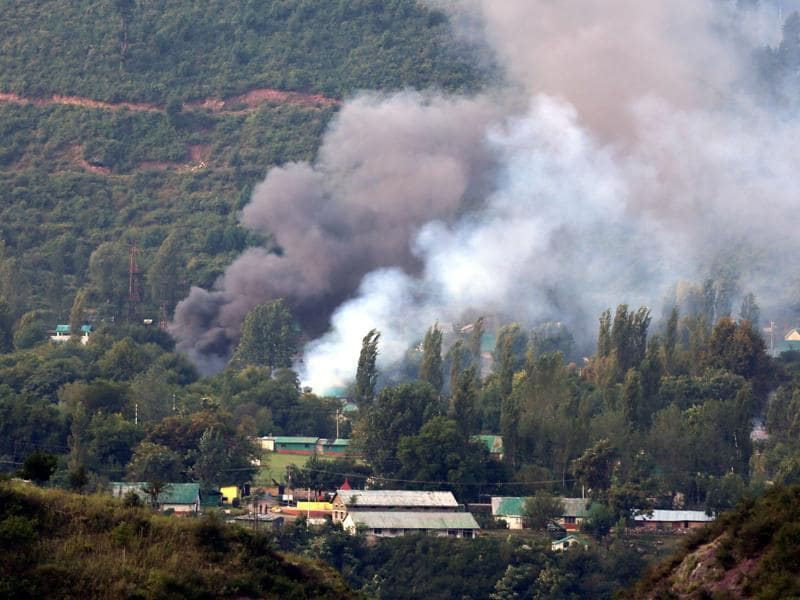 Smoke rises from the army base which was attacked by militants in the town of Uri, west of Srinagar, on September 18, 2016. Eighteen soldiers were killed that day, and the attack has become a major flashpoint between India and Pakistan. (HT photo)