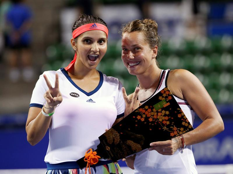 Sania Mirza of India (L) and Barbora Strycova of Czech Republic pose with their victory trophy on Septmber 24, 2016 after the Pan Pacific Open Women's Doubles Final match in Ariake Coliseum, Tokyo, Japan. (Kim Kyung-Hoon/REUTERS)