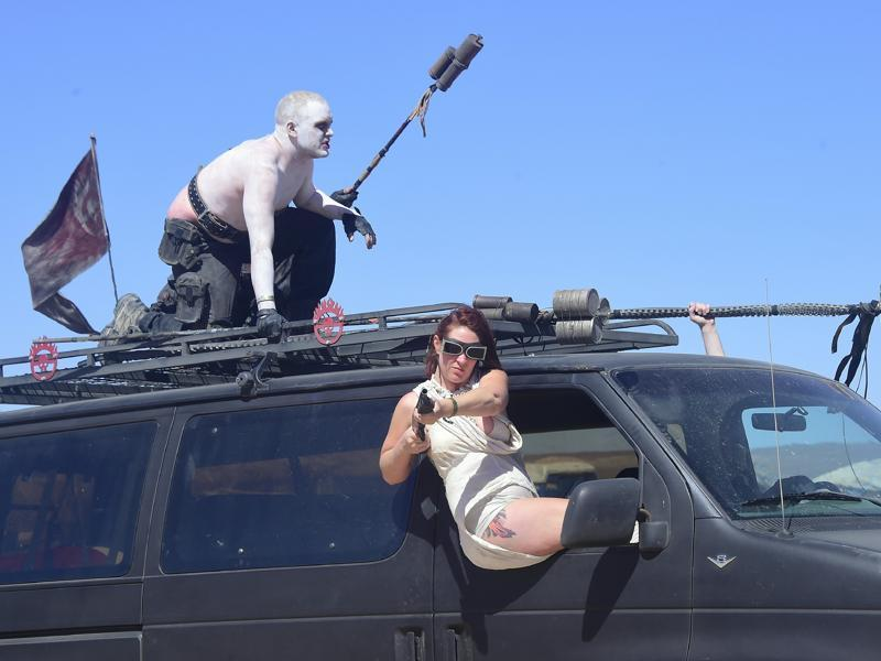 There's no dress code for the vehicles, but every year a fleet of Mad Max-style junkyard monsters turn up, mounted with gun turrets or armed with metal spikes. (AFP)
