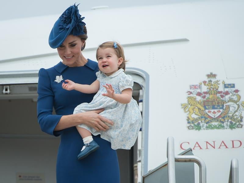 But lets talk about Princess Charlotte. She wore an adorable, flowery dress in the lightest shade of blue, complimenting her mum so well. (AFP)