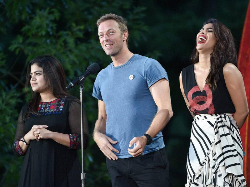Member of Parliament from Mumbai North Central Poonam Mahajan, left, musician Chris Martin and actor Priyanka Chopra speak at the 2016 Global Citizen Festival in Central Park. (AP)