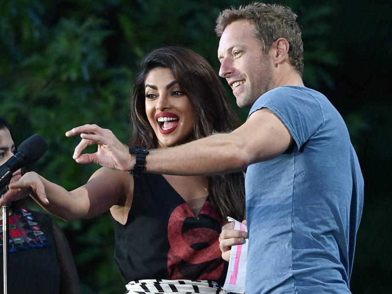 Actor Priyanka Chopra, left, and musician Chris Martin speak at the 2016 Global Citizen Festival in Central Park on Saturday. (AP)