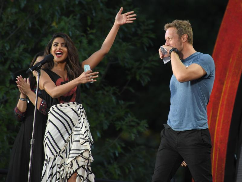 Priyanka Chopra and musician Chris Martin onstage at the 2016 Global Citizen Festival in Central Park, an event staged to end extreme poverty by 2030. (AFP)