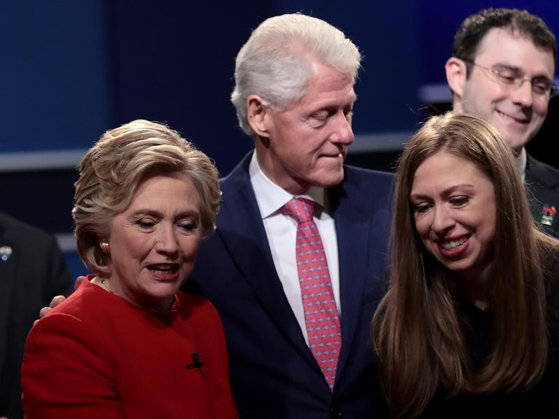 (From left) Democratic presidential nominee Hillary Clinton looks on with husband and former US president Bill Clinton and daughter, Chelsea Clinton after the presidential debate with Republican presidential nominee Donald Trump at Hofstra University in Hempstead, New York.  (AFP Photo)