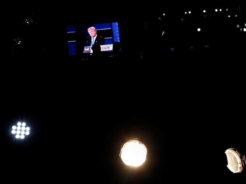 US Republican nominee Donald Trump is seen telecasted on a video screen outside Hofstra University. (Reuters Photo)