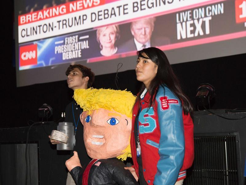 Area students stand with a Donald Trump pinata during a presidential debate watch party in Dallas, Texas (AFP Photo)
