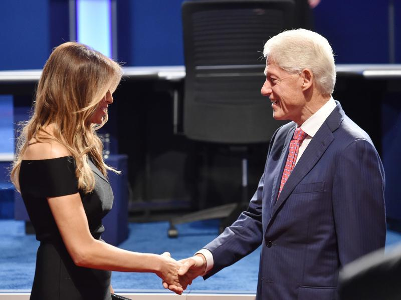 Melania Trump and former US president Bill Clinton check hands before the first presidential debate at Hofstra University in Hempstead, New York. (AFP Photo)