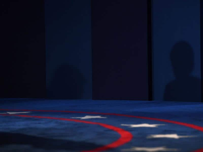 The shadows of Republican nominee Donald Trump (left) and Democratic nominee Hillary Clinton are seen during the first presidential debate at Hofstra University in Hempstead, New York. (AFP Photo)