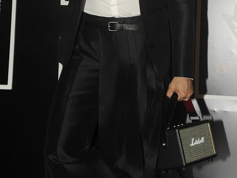 Also, don't miss his awesome man bag... (AFP)