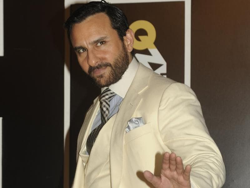 Daddy-to-be Saif Ali Khan also turned up looking dapper as ever in a white suit and an attitude to match. (AFP)