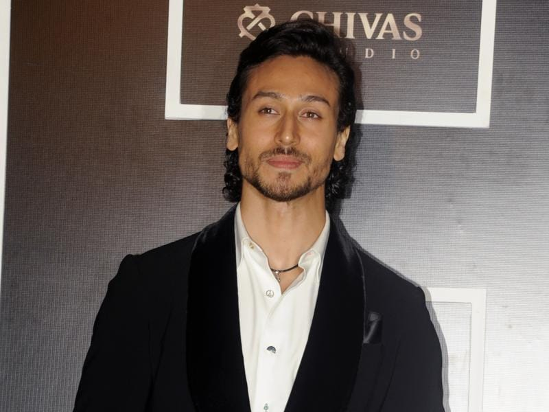 Tiger Shroff kept it cool and simple with a black jacket over a white shirt. (AFP)