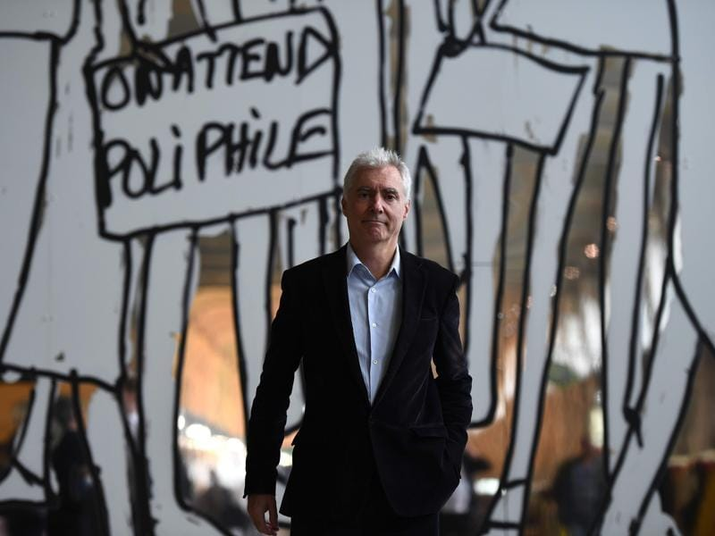 French artist Alain Sechas poses in front of an artwork. (AFP)
