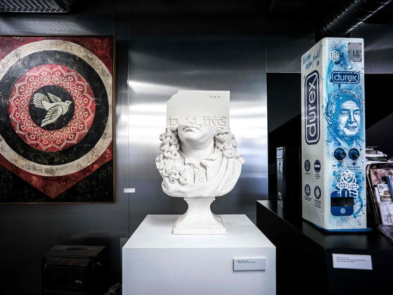 Pieces of street art (fromL) Doves (Black) by US artist Shepard Fairey, Loading... by French artist Rero and 'Spray on DUREX metal dispenser'. The first entrance free and permanent street art museum in France will open its doors to the public during the festival. (AFP)