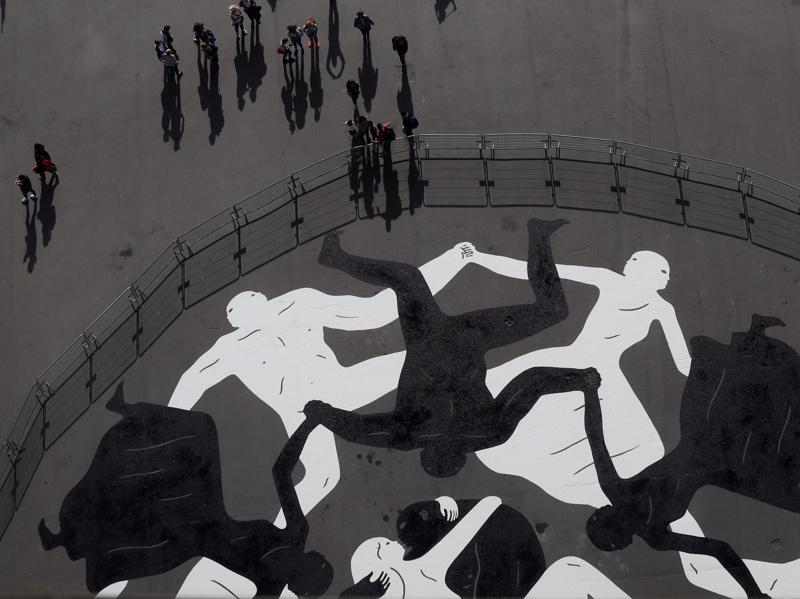 Endless Sleep, a mural by US artist Cleon Peterson painted under the Eiffel Tower, as part of the Nuit Blanche festival, that will take place on first October.  (AFP)