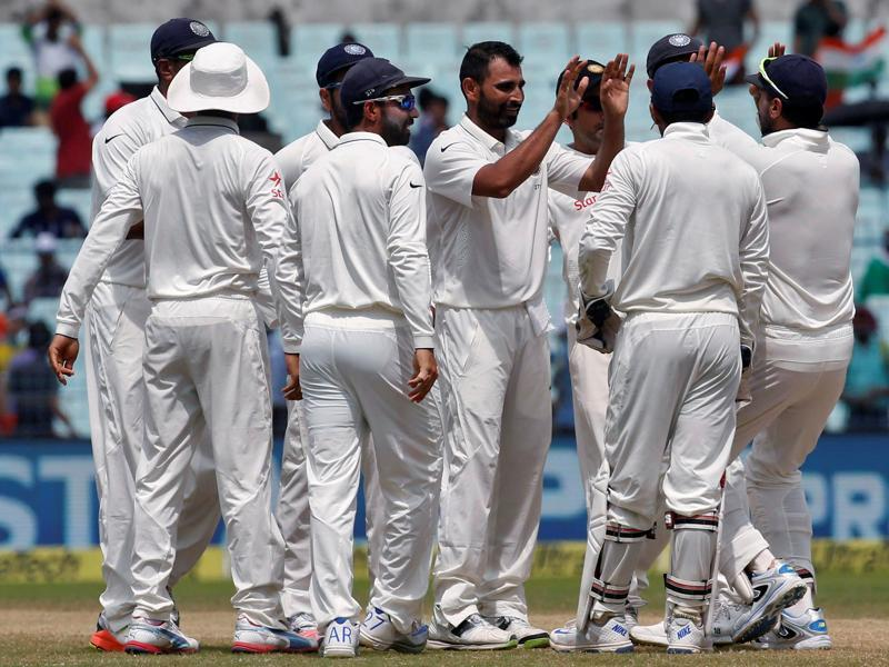 India's Mohammed Shami celebrates with teammates after taking the wicket of Tom Latham. (REUTERS)