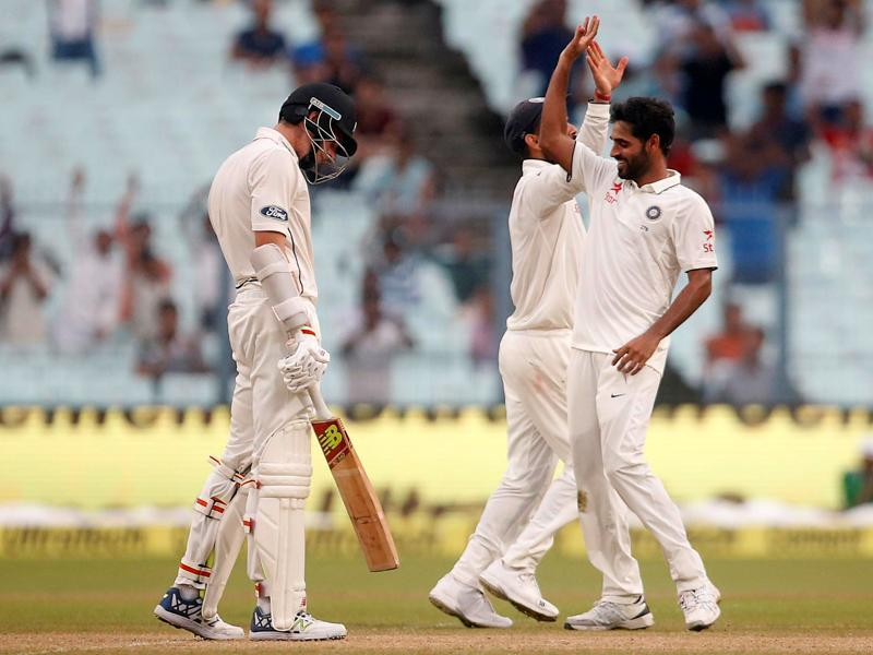 Bhuvneshwar Kumar (R) celebrates after taking the wicket of Mitchell Santner. (REUTERS)