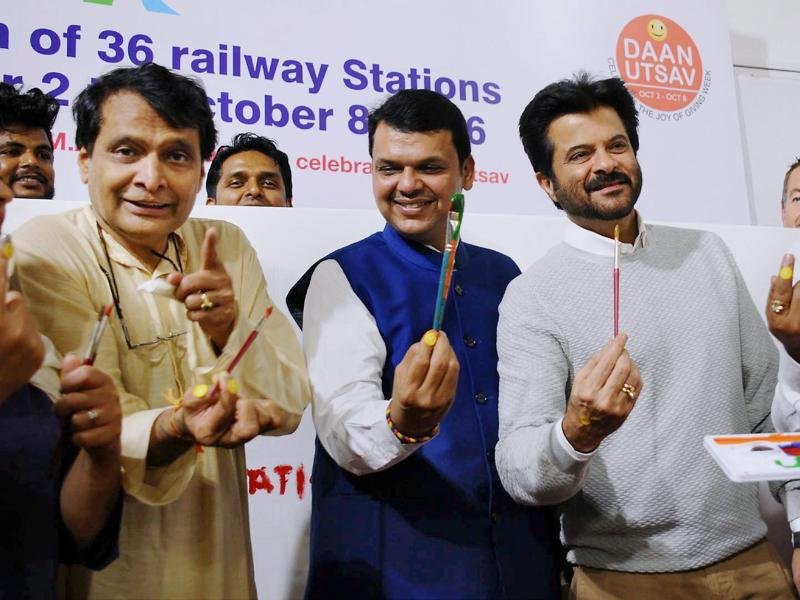 Union Railway Minister Suresh Prabhu, Chief Minister of Maharashtra Devendra Fadanvis and Bollywood actor Anil Kapoor during the launch of beautification of 36 suburban railway stations of Mumbai on the occasion of Gandhi Jayanti. (PTI Photo)