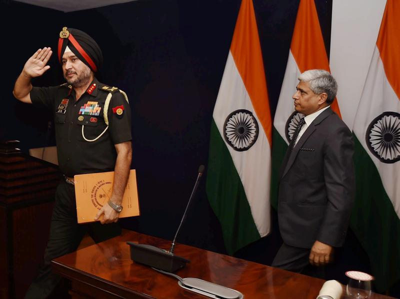 Director general military operations (DGMO), Ranbir Singh salutes after a press conference along with external affairs spokesperson Vikas Swarup, in New Delhi.  (PTI Photo)