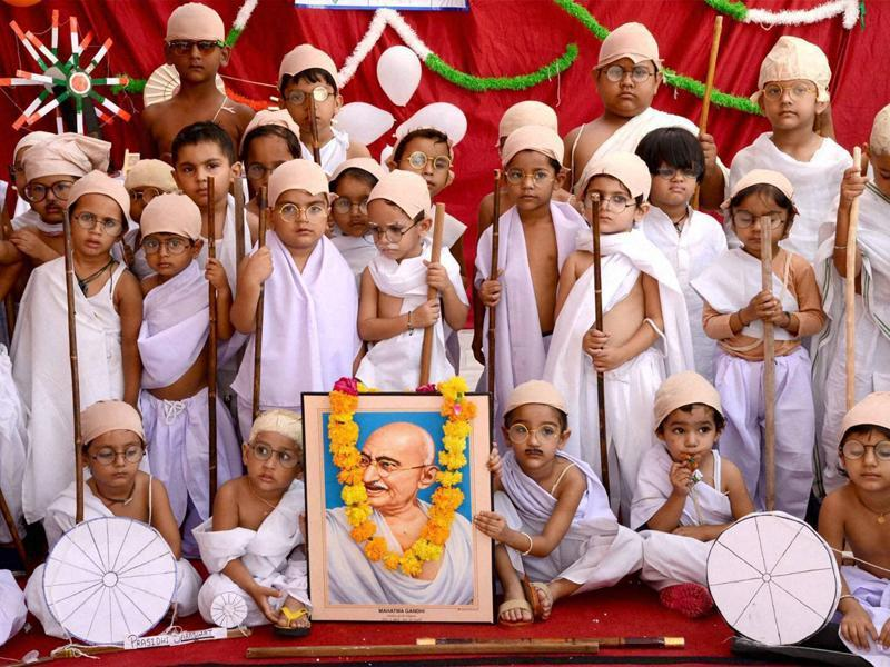 Children in Ajmer dress up as Mahatma Gandhi to mark the Father of the Nation's 147th birth anniversary on Saturday.  (PTI Photo)