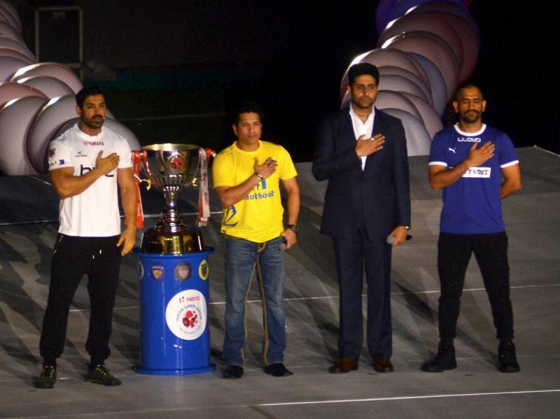 Bollywood actor Abhishek Bachchan, cricket Legend, Sachin Tendulkar, cricketer, Mahendra Singh Dhoni and actor and owner of NorthEast United Football team John Abraham reveal the ISL trophy at inaugural ceremony of the 3rd edition of Indian Super League 2016 (ISL) in Guwahati. (PTI Photo)