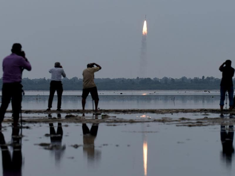 Residents photograph the launch of the Indian Space Research Organisation (Isro) Polar Satellite Launch Vehicle (PSLV-C35), carrying equipment which will be used to monitor oceans and weather at Sriharikota in Andhra Pradesh. (AFP Photo)
