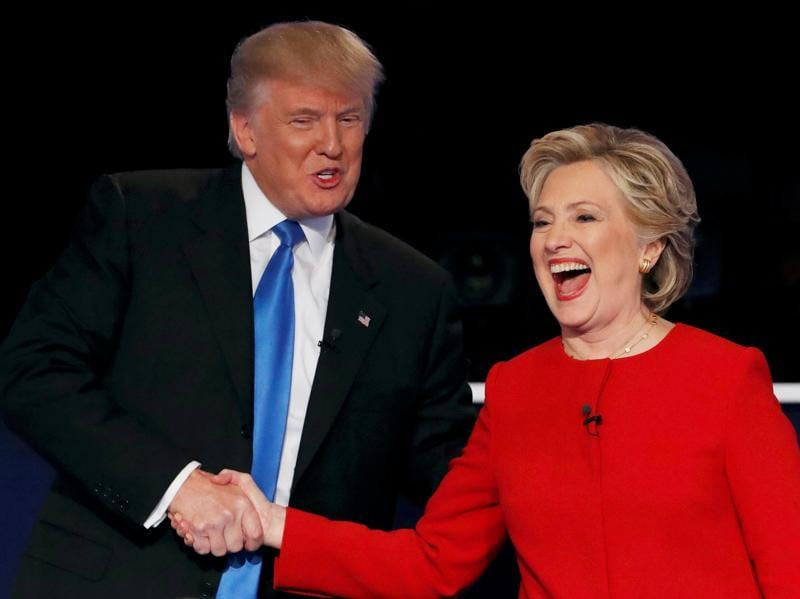 Republican US presidential nominee Donald Trump shakes hands with Hillary Clinton at the conclusion of their first presidential debate at Hofstra University in Hempstead, New York. (Reuters Photo)