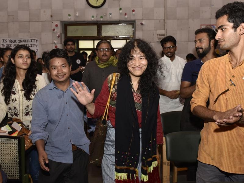 Irom Chanu Sharmila with students on the occasion of 120th birth anniversary of Hijam Irabot during a seminar at Social Work Department in Delhi University. (Arvind Yadav/HT Photo)