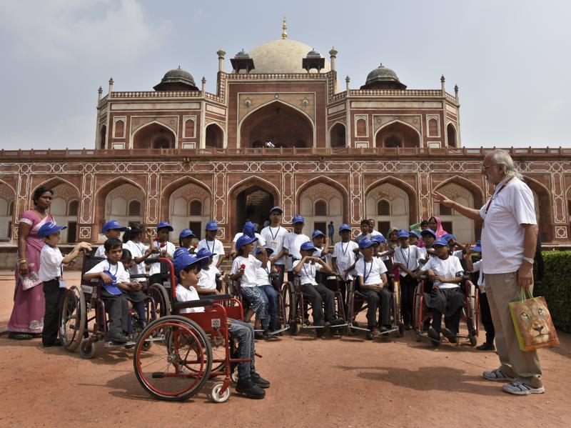 Differently-abled school students visit Humanyun Tomb on the occasion of World Tourism Day Road in New Delhi. (Sushil Kumar/HT Photo)