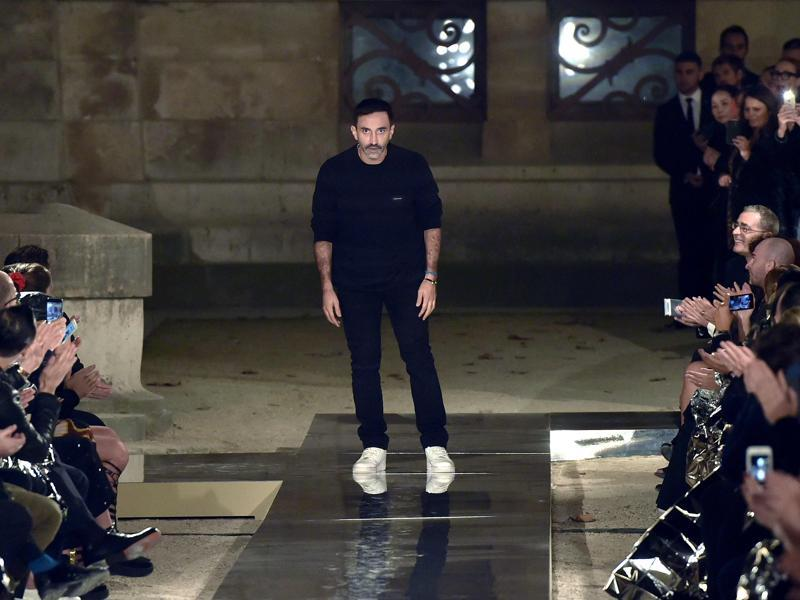 Fashion designer Riccardo Tisci acknowledges the audience at the end of the show. (AFP)