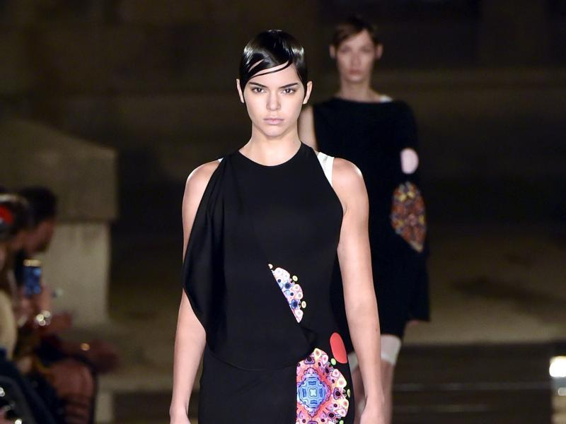 US model Kendall Jenner presents a creation for Givenchy on Sunday. (AFP)