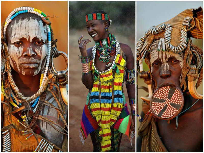 Women from the Mursi tribe (far left and right) pose for a photo in the Mago National park near Jinka in Ethiopia's southern Omo Valley region on September 21, 2016. The Mursi are a Nilotic pastoralist ethnic group which number around 10,000 people in Ethiopia. Some Mursi women choose to wear a saucer' lip plate (dhebi a tugoin). A girl's lower lip is cut when she reaches the age of 15 or 16. The wound is then stretched over time to accomodate a large clay plate. The Mursi tribe is one of the few tribes left who continue this practise. A woman from the Bena tribe (centre) eats honey collected from a tree in Turmi, Ethiopia on September 20, 2016.  (AFP)