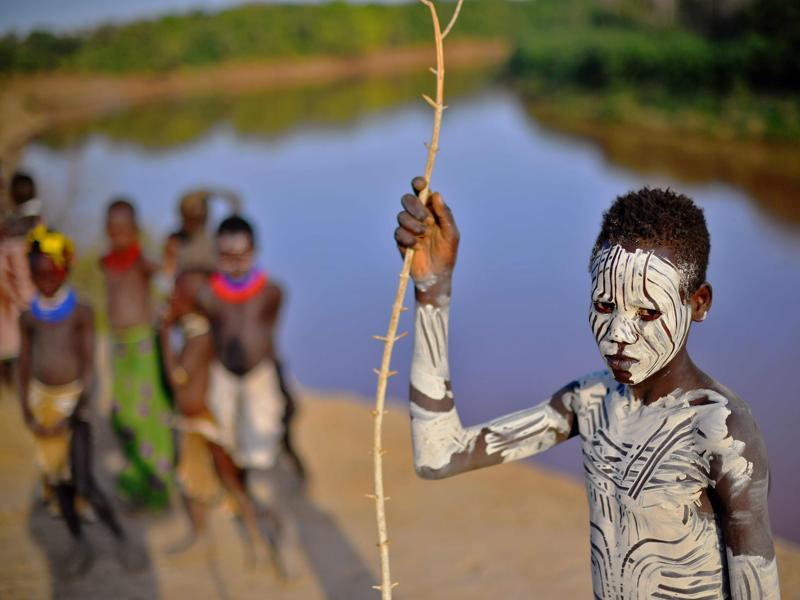 A boy from the Karo tribe poses for a photo in front of the Omo river on September 23, 2016.   (AFP)