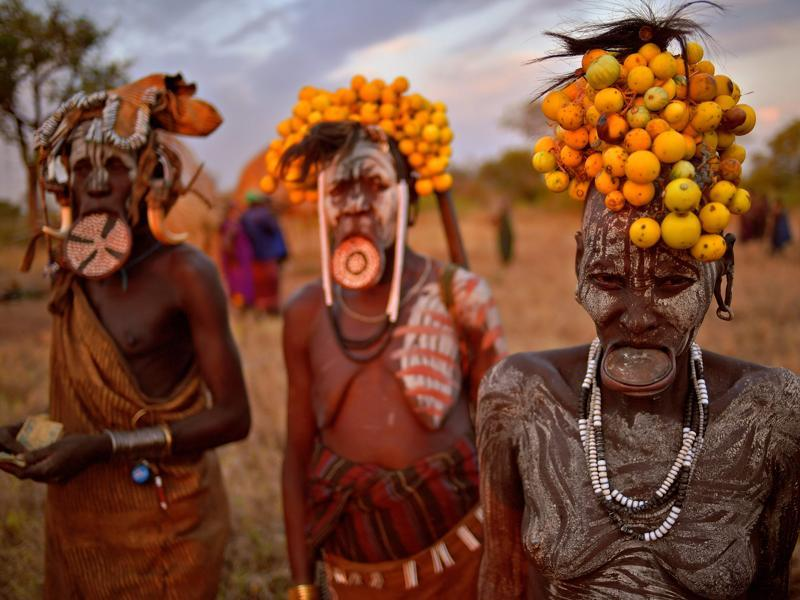 Women from the Mursi tribe pose for a photo in the Mago National park near Jinka on September 21, 2016.   (AFP)