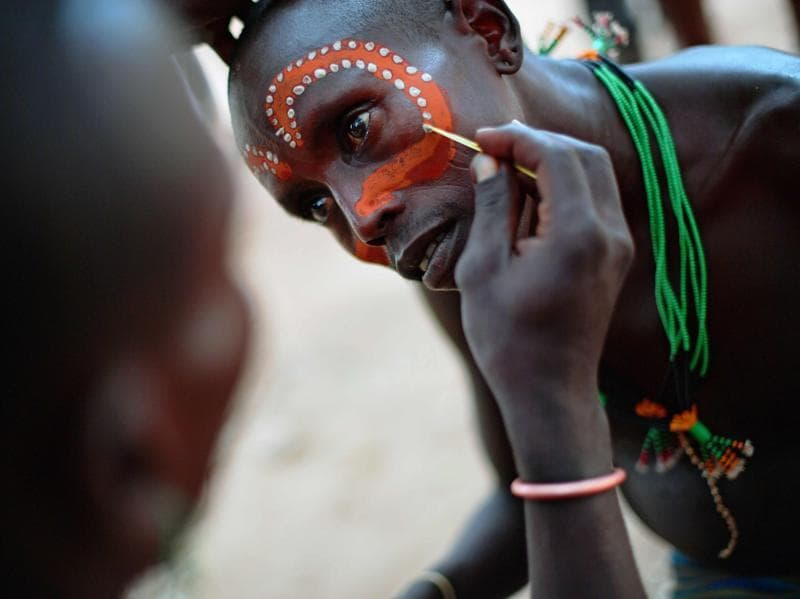 "A Hamar man has his face painted before a bull jumping ceremony in Omo Valley region near Turmi on September 19, 2016. The Hamar are a Nilotic ethnic group in Ethiopia. Bull jumping has been practised by the Hamars for thousands of years. The ceremony is a coming of age tradition which allows young men to marry. The man has to run across the backs of bulls which have been lined up, 4 times. If he falls through the row of bulls he is to start again until he finishes without falling. If the man fails to properly ""jump the bulls"" he risks humiliation and being cast out by his village as well as never being able to marry in the future. Before the ceremony women line up to be whipped by men holding sticks to prove their devotion to the men. (AFP)"